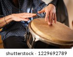 Percussion Instrument Being...