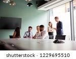 group collaborating on task at... | Shutterstock . vector #1229695510