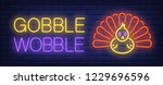 gobble wobble neon text with... | Shutterstock .eps vector #1229696596