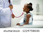 friendly pediatrician... | Shutterstock . vector #1229758030