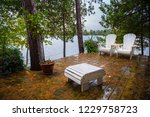 white chairs on a cottage porch ... | Shutterstock . vector #1229758723