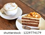 pistachio cake and hot coffee... | Shutterstock . vector #1229774179