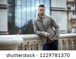 handsome male model wear gray... | Shutterstock . vector #1229781370