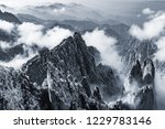 clouds by the mountain peaks of ... | Shutterstock . vector #1229783146