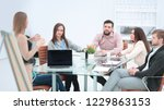 business team discussing the... | Shutterstock . vector #1229863153
