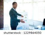 successful businessman pointing ... | Shutterstock . vector #1229864050