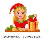 elf girl decorates christmas... | Shutterstock .eps vector #1229871136