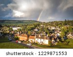 aerial view of a rainbow over... | Shutterstock . vector #1229871553