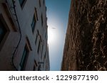 between city wall and building | Shutterstock . vector #1229877190