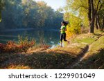 woman excersising in the... | Shutterstock . vector #1229901049