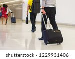 blur of people at airport. | Shutterstock . vector #1229931406