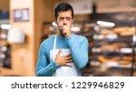 man wearing an apron is... | Shutterstock . vector #1229946829