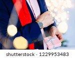handsome man in red santa claus ... | Shutterstock . vector #1229953483