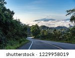 country road to paradise of... | Shutterstock . vector #1229958019