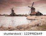 wooden windmills on zaan river...   Shutterstock . vector #1229982649