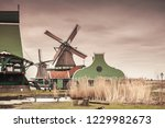 old wooden barns and windmill...   Shutterstock . vector #1229982673