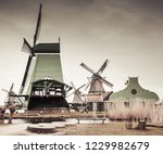 wooden barns and windmills on...   Shutterstock . vector #1229982679