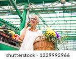 portrait of senior woman buying ... | Shutterstock . vector #1229992966