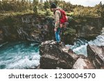 hiker man standing on cliff... | Shutterstock . vector #1230004570