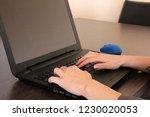 hands working with computer | Shutterstock . vector #1230020053
