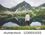 man traveling alone looking at... | Shutterstock . vector #1230031033