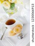 a tray with a teacup tea pot... | Shutterstock . vector #1230066913