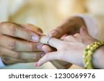 wedding rings. he put the... | Shutterstock . vector #1230069976