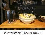 Set Of Kitchen Ware On Shelf...