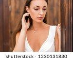girl on a tropical beach in... | Shutterstock . vector #1230131830