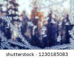 Frosty snowflake pattern on a...