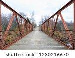 old metal and wood bridge over... | Shutterstock . vector #1230216670