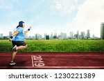 asian fat man running on... | Shutterstock . vector #1230221389