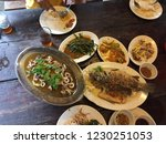 different thai dishes on a table | Shutterstock . vector #1230251053