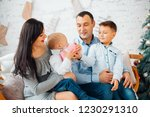 happy young family with two...   Shutterstock . vector #1230291310