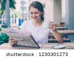 young woman drinking coffee and ... | Shutterstock . vector #1230301273