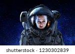 attractive woman in spacesuit | Shutterstock . vector #1230302839