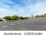 asphalt road along the coast... | Shutterstock . vector #1230311686