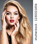 pretty girl posing at studio...   Shutterstock . vector #1230321856