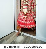 indian bride pushes rice pot on ...   Shutterstock . vector #1230380110