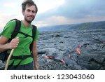 hawaii hiker hiking by flowing...