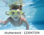 young child diving underwater... | Shutterstock . vector #123047254