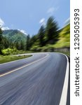 the highway is in green forest. | Shutterstock . vector #1230505393