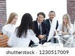 handshake business women with... | Shutterstock . vector #1230517009