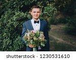 a young and stylish groom...   Shutterstock . vector #1230531610
