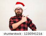handsome bearded man in santa... | Shutterstock . vector #1230541216