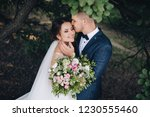 beautiful newlyweds cuddle in a ...   Shutterstock . vector #1230555460