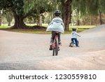 two australian kids riding...   Shutterstock . vector #1230559810