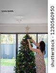 woman decorating australian...   Shutterstock . vector #1230560950