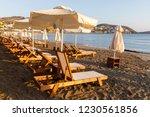 umbrellas and sunbeds on a... | Shutterstock . vector #1230561856
