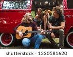 group of excited hippies men... | Shutterstock . vector #1230581620